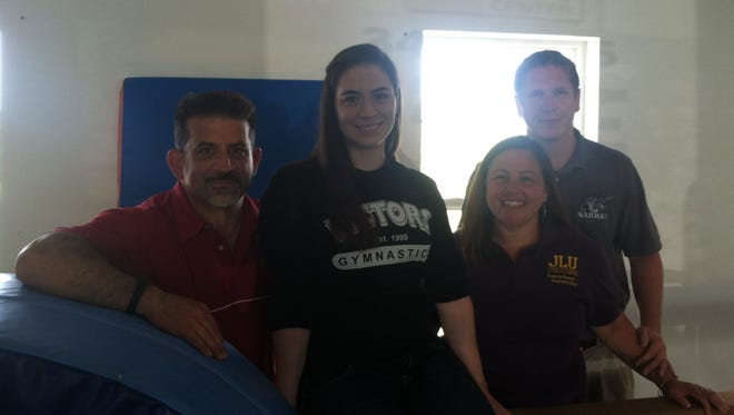 From left, Michael Mordenga, Liz Mordenga, Leslie Ball and the Rev. Mark Ball at the new gymnastics facility within JLU Child Care in Spencerport.