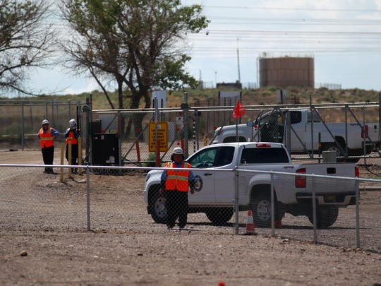 Dinéland Protection Services employees watch man the gates, Wednesday, Aug. 23, 2017 at the Navajo Mine North Facility, south of Farmington.