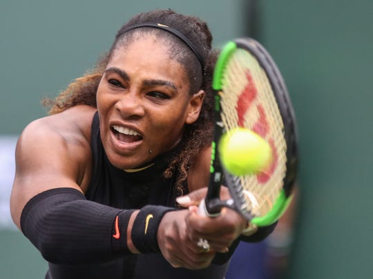 Serena Williams returns the ball to Kiki Bertens, of the Netherlands in the women's 2nd round at the BNP Paribas Open on Saturday, March 10, 2018 in Indian Wells.