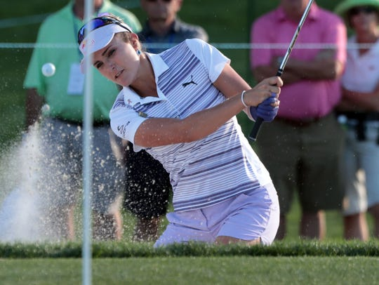 American Lexi Thompson hits her bunker shot on 9 during
