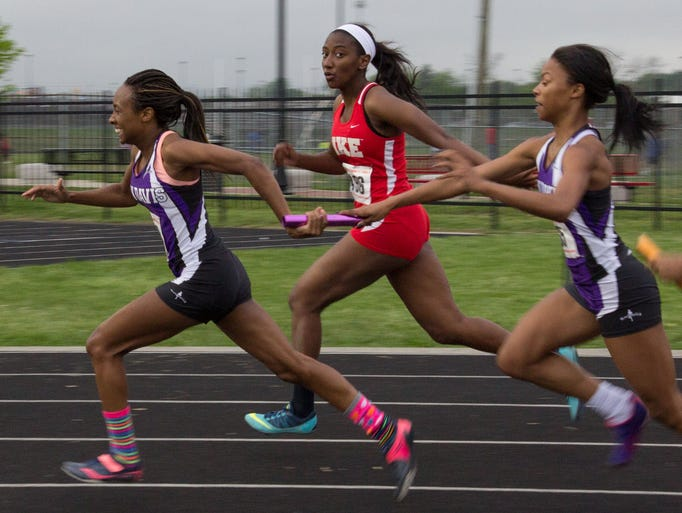 Ben Davis' Ravon Woodson takes the baton from Devyn Vandever and goes on to win the 400x100 relay in a time of 48.64 at the Marion County Girls Track Meet at North Central High School, May 13, 2014.