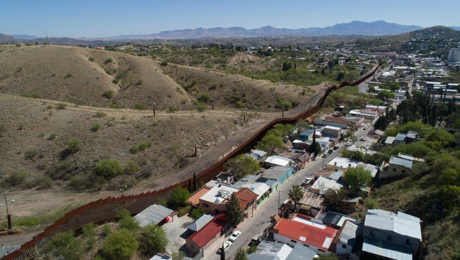 This Sunday, April 2, 2017 file photo made with a drone, shows the U.S. Mexico border fence as it cuts through the two downtowns of Nogales. The fence meant to divide serves as a meeting place for family and friends. An old case — this one little-known even inside Mexico — has been brought up by Sen. Patricio Martinez, who claims that the present borders in southwestern New Mexico and Arizona are wrong due to a surveying error after the 1853 Gadsden Purchase, in which the U.S. acquired almost 30,000 square miles from Mexico in exchange for $10 million.