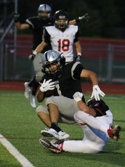 Lunging toward the goal line for Plymouth is sophomore running back Carson Miller, who scored twice against Churchill.
