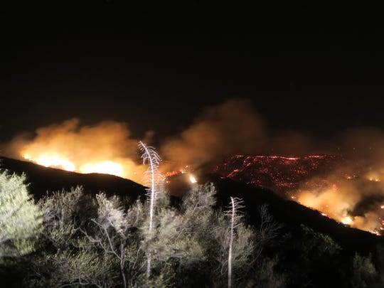 The Thomas Fire lit up hillsides above Santa Barbara and Montecito Saturday night as winds pushed flames downhill towards homes. The fire was also active over the weekend outside Fillmore.