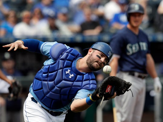 Kansas City Royals catcher Cam Gallagher drops a foul ball hit by Seattle Mariners' Kyle Seager during the first inning of a baseball game at Kauffman Stadium in Kansas City, Mo., Wednesday, April 11, 2018. (AP Photo/Orlin Wagner)