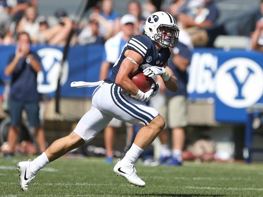 BYU's Zayne Anderson (23) carries the ball after his