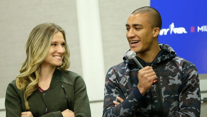 In this Feb. 18, 2016, file photo, Ashton Eaton, right, and his wife, Brianne Theisen-Eaton, participate in a news conference in New York.