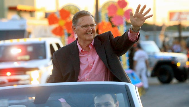 Mayor-elect Joe McComb waves at a crowd as he participates in the Buc Days Illuminated Night Parade on Saturday, May 6, 2017, in Corpus Christi.