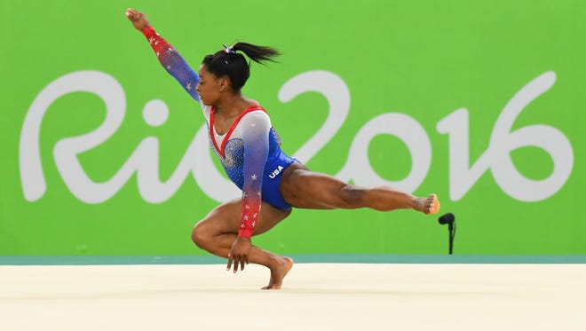 This file photo from the 2016 Summer Olympics shows Simone Biles competing during to the women's floor exercise final at Rio Olympic Arena in Rio de Janeiro.