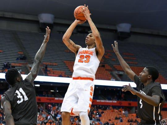 Syracuse guard Malachi Richardson (23) shoots between Lehigh Mountain Hawks forward Jesse Chuku (31) and guard Austin Price (5).