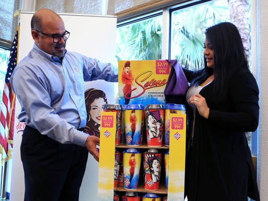 Eduardo Pereda, vice-president convenience store brands Sunoco LP, and Suzette Quintanilla Arriaga unveil two commemorative collectable Selena cups that will be sold at Stripes stores as part of Fiesta de la Flor during a press conference on Monday, February 20, 2016.
