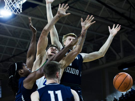 Florida Gulf Coast University forward Brady Ernst (21) loses the ball after an attempted rebound during their game against the University of North Florida at Alico Arena on Monday. The Eagles beat the Ospreys 103-70.