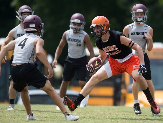 Bearden players defend a Greenback player during the