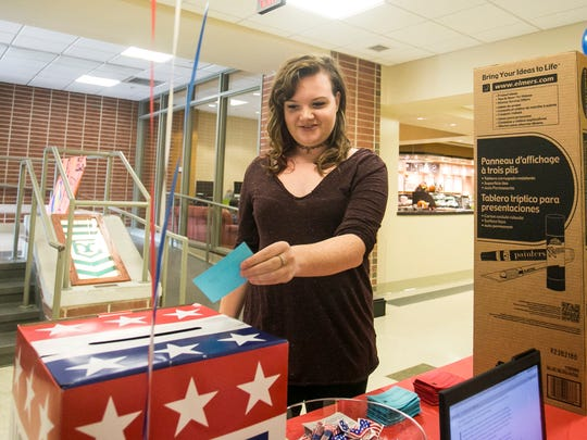 York College junior Megan Burchfield, of Birmingham, Alabama, makes her mock election vote by selecting Hillary Clinton as her choice for President on Tuesday, Oct. 4, 2016. Amanda J. Cain photo