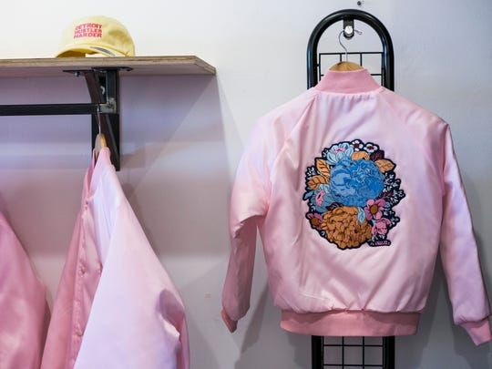 A bomber jacket with a design by local artist Quizi
