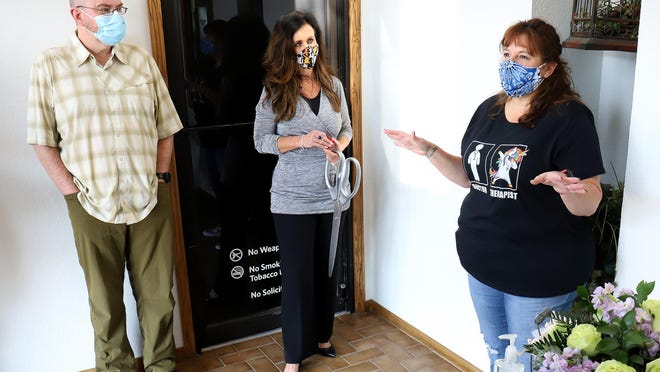 Founder and clinician Melanie Taylor, LPC-S, right, talks about the mission of the Healing Tree Women's Counseling Center, 5004 S U St., Suite 203, during the ribbon cutting for the Greater Fort Smith Chamber of Commerce, Tuesday, Oct. 6.