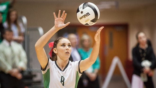 Yorktown's Jade York serves to Providence on Saturday during the IHSAA Class 3A State Tournament in Worthen Arena. Yorktown lost to Providence 3-0.