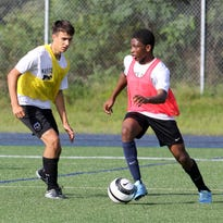 The Elmira Notre Dame boys soccer team practices Friday morning at Brewer Memorial Stadium.