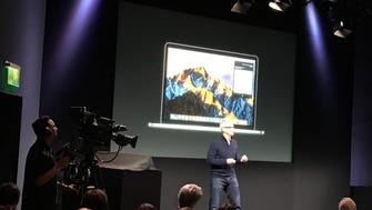 Apple CEO Tim Cook unveils the new MacBooks at an event in Cupertino Thursday.