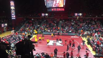 Rutgers and Iowa, shown warming up before their match against each other Friday night at the Rutgers Athletic Center