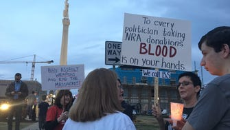 Around 40 protesters stood in downtown Franklin asking for tighter gun control laws after the Parkland, Fla., shooting.