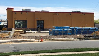 Workers are preparing Popeyes Louisiana Kitchen in Toms River.