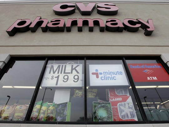 This May 4, 2009 photo, shows a CVS pharmacy in Worth, Ill. Drug chains CVS and Walgreens, as well as grocery chain Wegmans Food Market, have joined the chorus of retailers requesting that customers refrain from openly carrying firearms in their stores even where state laws allow it. (AP Photo/M. Spencer Green, File)