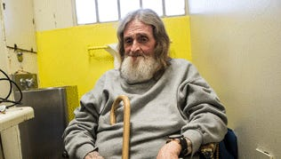 Frank Fuller, who has hepatitis C, sits in his prison cell in California Men's Colony prison in San Luis Obispo, Calif. New drugs could wipe out the hepatitis C virus, which is rampant in prisons, but states may not be able to afford to give them to inmates.