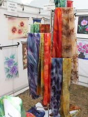 These burnout silk scarves by Jean Lawrence of Corvallis are on sale for $30 apiece at the 66th annual Salem Art Fair & Festival.