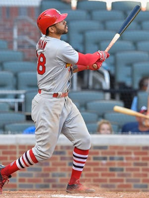 Tommy Pham watches his home run in the 14th inning leave the park in the Cardinals' 6-4 win over the Braves.