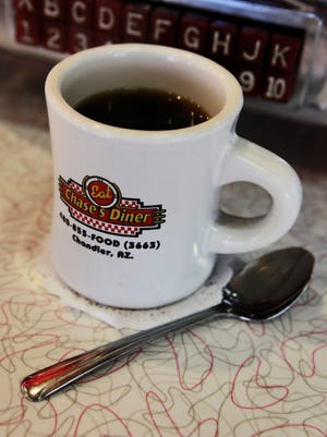 A coffee cup sits on the counter at Chase's Diner in Chandler.