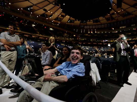 David Finn, 22, from Ramsey, N.J., sits in the front