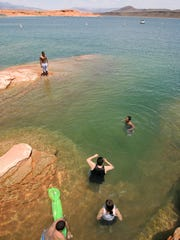 Swimmers enjoy the cool waters of Sand Hollow Reservoir in Hurricane. The shallow waters along the shores of Sand Hollow are popular for swimming in summer.