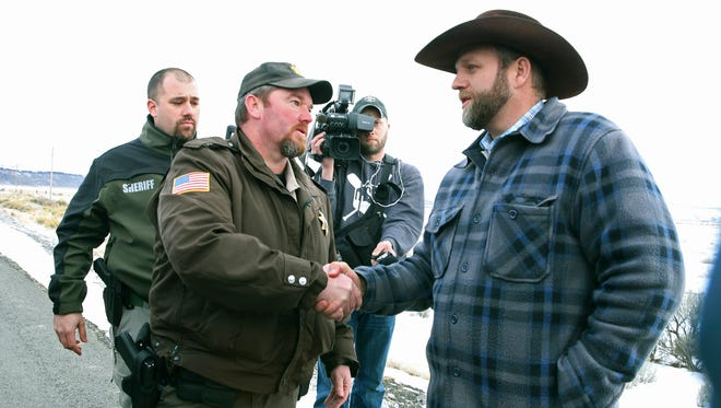 Harney County Sheriff Dave Ward meets with Ammon Bundy at a remote location outside the Malheur National Wildlife Refuge on Thursday, Jan. 7, 2016, near Burns. Three Oregon sheriffs met Thursday with the leader of an armed group occupying a federal wildlife refuge and asked them to leave, after residents made it clear they wanted them to go home. Ward said via Twitter that he asked Bundy to respect the wishes of residents.  Ward said the two sides planned to talk again Friday.