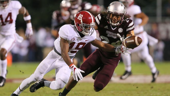 Mississippi State's Chris Rayford (24) and Alabama's Xavian Marks (19) scramble for a loose ball on a mishandled punt Saturday in Starkville.