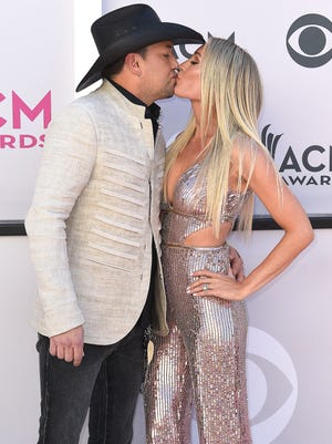 Jason Aldean and Brittany Kerr kiss during the 52nd Academy of Country Music Awards red carpet at T-Mobile Arena on Sunday, April 2, 2017, in Las Vegas, Nev.