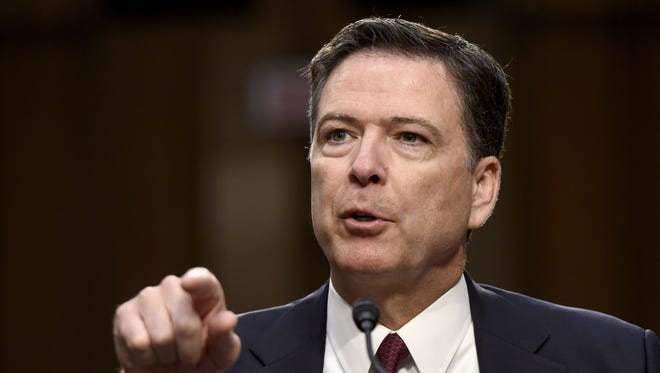 This June 8, 2017, file photo shows former FBI director James Comey testifying before Senate Intelligence panel on Capitol Hill on June 8, 2017.