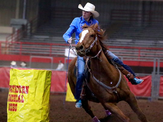 Cami Reed 14, of Aztec, competes in barrel racing during