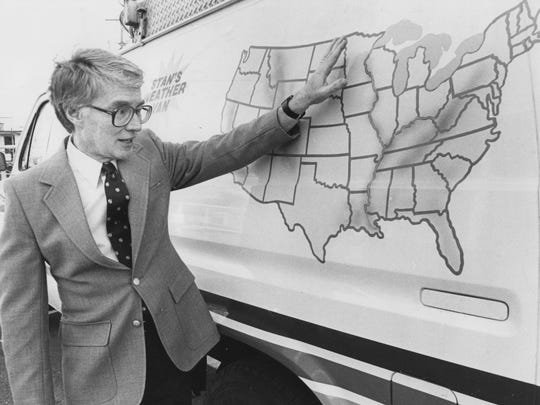 In this 1985 photo, weather forecaster Stan Wood gestures