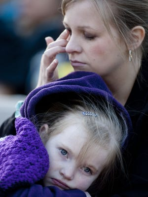 In this March 2013 file photo, Jessica Lynch and her daughter, Dakota Robinson, then 6, attend  a sunrise memorial at Piestewa Peak in Phoenix. Lynch was injured and her friend Lori Piestewa of Arizona lost her life while serving in the military during the Iraq war.