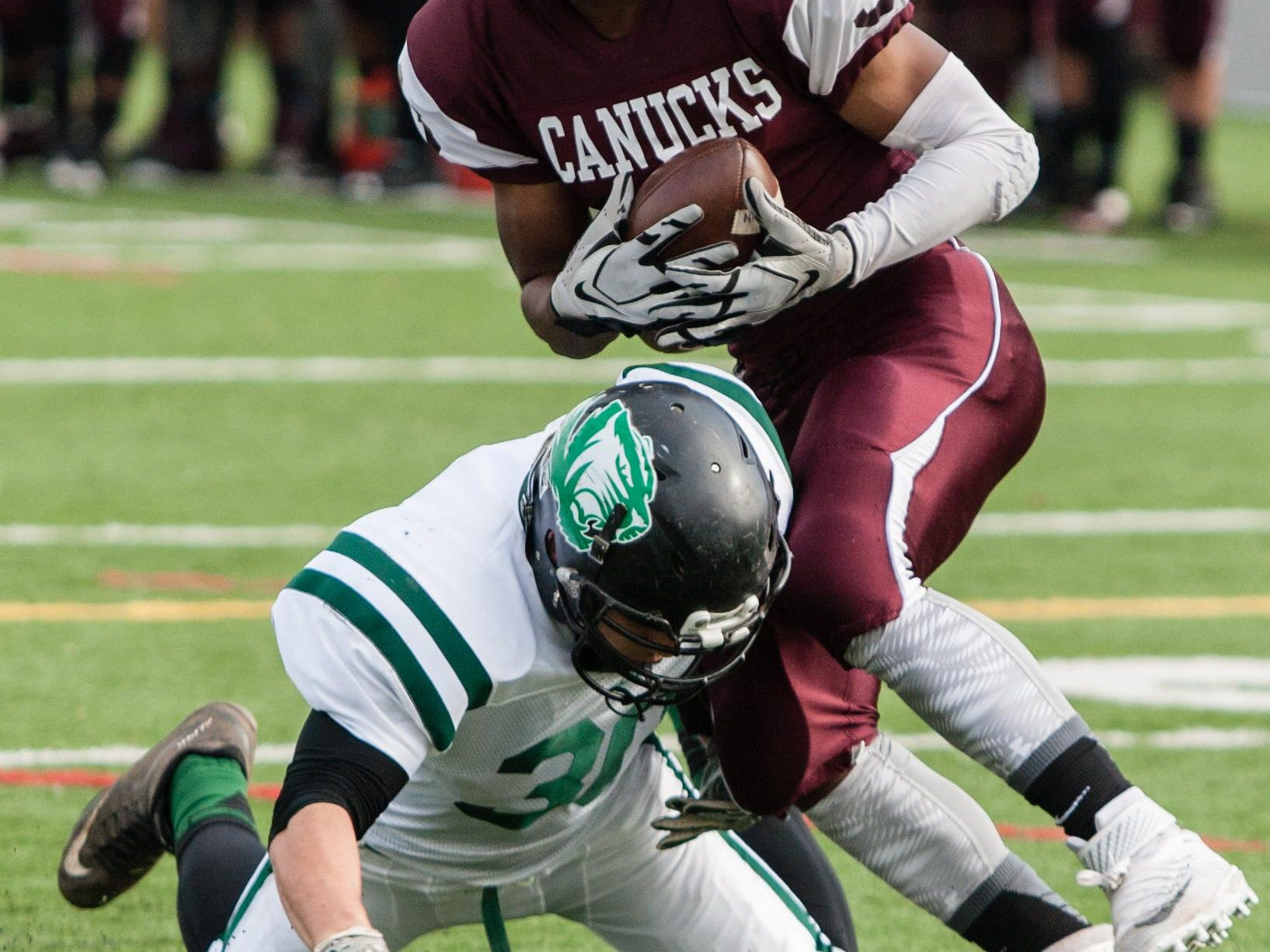 South Plainfield's Benjamin Lundy tackles North Plainfield's Dennis Cooper during their Thanksgiving Day game at Krausche Field in North Plainfield.