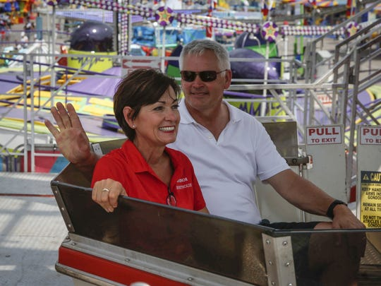 Iowa Gov. Kim Reynolds and her husband, Kevin, ride the Ferris Wheel on Thursday, August 10, 2017, during the Iowa State Fair in Des Moines.