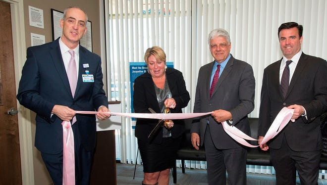 Pictured from left are Eric Carney, Chief Operating Officer, Monmouth Medical Center; Howell Mayor Theresa Berger; Frank J. Vozos, MD, FACS, Executive Vice President, RWJBarnabas Health