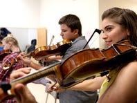 Salem Grad Visits Local Schools