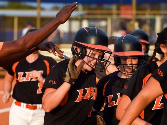 Layne Chesney, #6 on the Lincoln Park Academy softball