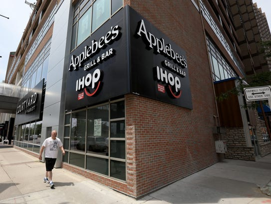 An exterior look at the signage at the Millender Center on Jefferson and Brush Street of the new Applebees IHOP restaurant at the Millender Center off Jefferson Avenue and Brush Street in Detroit.