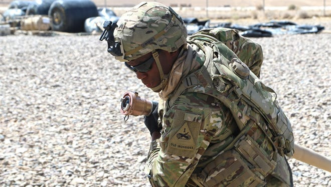 Sgt. Isaac Frazier, a petroleum supply specialist assigned to the 1st Armored Division Sustainment Brigade, assembles an Advance Aviation Forward Aerial Refueling System in Tarin Kowt, Afghanistan, in August. The system is used to expand the aerial capabilities of the Train, Advise and Assist Command-South.