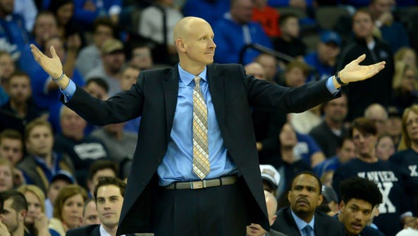 Xavier Musketeers head coach Chris Mack questions a