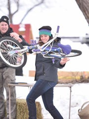 File photo from the annual bike toss contest held during the Fish Creek Winter Festival.