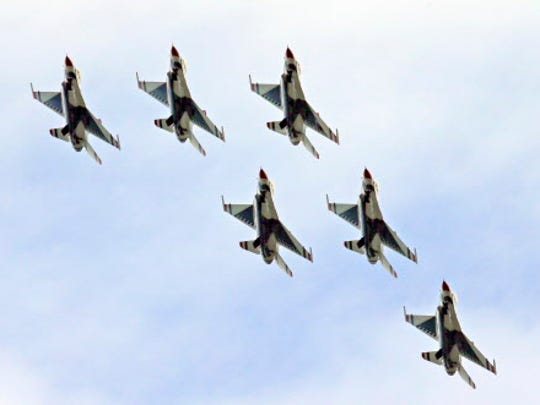 The Flying F-16C Fighting Falcon Thunderbirds perform at the Milwaukee Air & Water Show on Sunday, July 26, 2015.